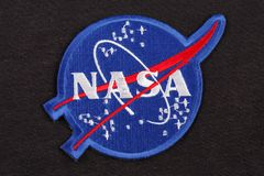 15 March 2018 - The National Aeronautics and Space Administration (NASA) emblem patch on black uniform. Background stock photos