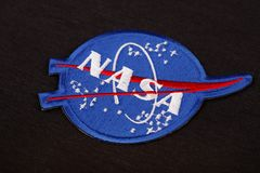 15 March 2018 - The National Aeronautics and Space Administration (NASA) emblem patch on black uniform. Background royalty free stock photo