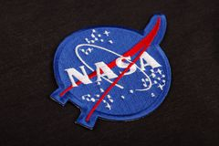 15 March 2018 - The National Aeronautics and Space Administration (NASA) emblem patch on black uniform. Background stock images