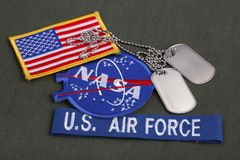 15 March 2018 - The National Aeronautics and Space Administration (NASA) emblem patch, dog tags, US AIR FORCE branch tape and US. Flag patch on green uniform stock photo