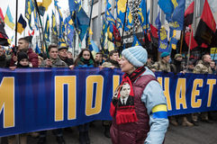 March of National Dignity in Kyiv. KIEV, UKRAINE - Feb 22, 2017: Activists of nationalist groups during the March of National Dignity. Inscription on poster stock photo