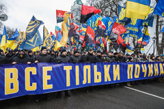 March of National Dignity in Kyiv. KIEV, UKRAINE - Feb 22, 2017: Activists of nationalist groups during the March of National Dignity. Inscription on the poster royalty free stock image
