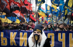 March of National Dignity in Kyiv. KIEV, UKRAINE - Feb 22, 2017: Activists of nationalist groups during the March of National Dignity. Inscription on poster stock images