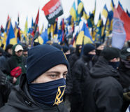 March of National Dignity in Kyiv. KIEV, UKRAINE - Feb 22, 2017: Activists of nationalist groups during the March of National Dignity to honor protesters who Stock Photo