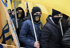 March of National Dignity in Kyiv. KIEV, UKRAINE - Feb 22, 2017: Activists of nationalist groups during the March of National Dignity to honor protesters who stock photos