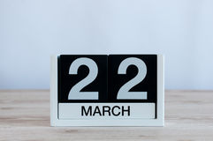 March 22nd. Day 22 of month, everyday calendar on wooden table background. Spring time, empty space for text Stock Image