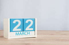 March 22nd. Day 22 of month, wooden color calendar on table background. Spring time, empty space for text Stock Image