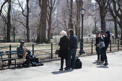 March 15, 2014, New York City: Tourists take photos of a musicia Royalty Free Stock Photo