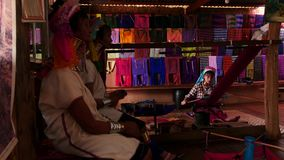 March 5 2016 Nyaungshwe, Myanmar. Paduang tribe of Myanmar long neck women indoors - 2 videos sequence. Paduang tribe of Myanmar long neck women indoors stock footage