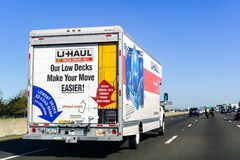 March 31, 2019 Oakland / CA / USA - U-Haul van travelling on the freeway in San Francisco bay area; U-Haul is an American company. Offering DIY moving solutions stock images