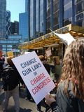 Change Gun Laws, Change Congress, March for Our Lives, Protest, NYC, NY, USA. During the March for Our Lives in New York City a demonstrator passes the Trump Stock Image