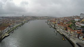 March 06, 2017 - Panoramic view of the city of Porto in Portugal. Boats on Douro river, famous Dom Luis I bridge and Ribeira. March 06, 2017 - Panoramic view of stock footage