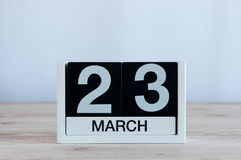 March 23rd. Day 23 of month, everyday calendar on wooden table background. Spring time, empty space for text Stock Photos