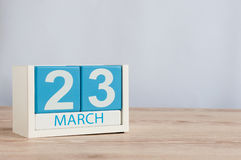 March 23rd. Day 23 of month, wooden color calendar on table background. Spring time, empty space for text Royalty Free Stock Photo