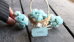 March 8. Rustic still life, roses and tag. March 8 label and beautiful basket of roses on vintage table stock video