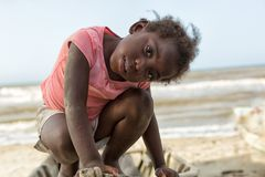 Young girl in La Ceiba Honduras. March 11, 2015 Sambo Creek, Honduras: a young garifuna girl part of the fishing community on the carribbean coast of the country stock images