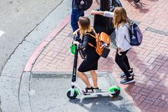 March 19, 2019 San Diego / CA / USA - Aerial view of young woman riding a lime scooter in downtown San Diego royalty free stock photos
