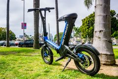 March 19, 2019 San Diego / CA / USA - Wheels custom designed mini bike parked in Balboa Park; Wheels is a new dockless e-vehicle. Start-up launched at the stock photo