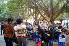 Shenzhen china: old people are singing. On March 22, 2013, shenzhen baoan haihua park, many old people are singing entertainment. Some people in the violin, some stock photo