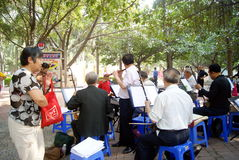 Shenzhen china: old people are singing. On March 22, 2013, shenzhen baoan haihua park, many old people are singing entertainment. Some people in the violin, some royalty free stock photos