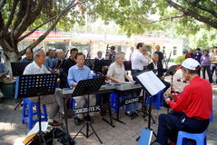 Shenzhen china: old people are singing. On March 22, 2013, shenzhen baoan haihua park, many old people are singing entertainment. Some people in the violin, some royalty free stock photography