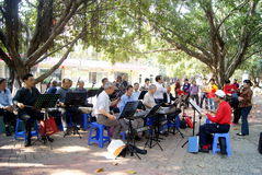 Shenzhen china: old people are singing. On March 22, 2013, shenzhen baoan haihua park, many old people are singing entertainment. Some people in the violin, some stock photos