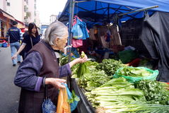 Shenzhen china: the old woman was buying vegetables Royalty Free Stock Images