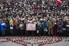 March of solidarity against terrorism at Kiev. KIEV, UKRAINE - Jan 18, 2015: Banners I Volnovaha and the lamps on Independence Square during the march of stock photos