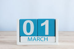 March 1st. Day 1 of month, daily calendar on wooden table background. Spring time, empty space for text Royalty Free Stock Images