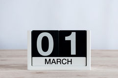 March 1st. Day 1 of month, everyday calendar on wooden table background. Spring time, empty space for text Stock Photo