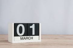 March 1st. Day 1 of month, wooden calendar on light background. Spring time, empty space for text Stock Photo