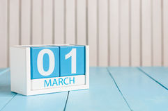 March 1st. Image of march 1 wooden color calendar on white background.  First spring day, empty space for text Royalty Free Stock Photos