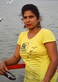 Beautiful Indian women portrait sitting in boat. royalty free stock photos