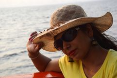 Beautiful Indian women portrait sitting in boat. royalty free stock image