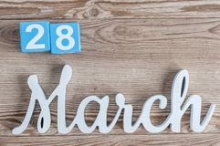 March 28th. Day 28 of march month, daily calendar on wooden table background with carved text. Spring time.  Stock Photo