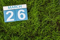 March 26th. Day 26 of month, calendar on football green grass background. Spring time, empty space for text.  Stock Photo