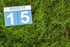 March 15th. Day 5 of month, calendar on football green grass background. Spring time, empty space for text. World. Consumer Rights Days Stock Photo