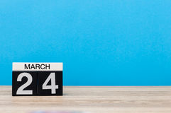 March 24th. Day 24 of month, calendar on table with blue background. Spring time, empty space for text Stock Images