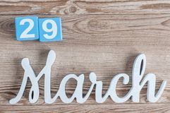 March 29th. Day 29 of march month, daily calendar on wooden table background with carved text. Spring time.  Stock Image