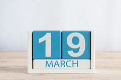 March 19th. Day 19 of month, daily calendar on wooden table background. Spring day. Earth Hour and International client Royalty Free Stock Photos