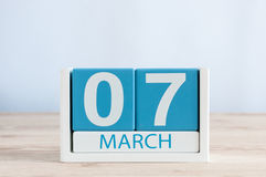 March 7th. Day 7 of month daily calendar on wooden table background. Spring day, empty space for text. March 7th. Image of march 7 wooden color calendar on white stock photography