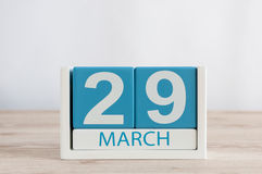 March 29th. Day 29 of month, daily calendar on wooden table background. Spring time, empty space for text. March 29th. Cube calendar for march 29 on wooden Royalty Free Stock Image