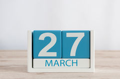 March 27th. Day 27 of month, daily calendar on wooden table background. Spring time, empty space for text. World Theatre Stock Image