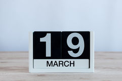 March 19th. Day 19 of month, everyday calendar on wooden table background. Spring day. Earth Hour and International Stock Image