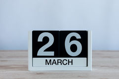 March 26th. Day 26 of month, everyday calendar on wooden table background. Spring time, empty space for text Royalty Free Stock Photography