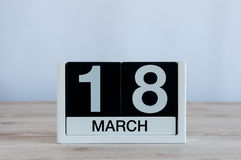March 18th. Day 18 of month, everyday calendar on wooden table background. Spring time, empty space for text Royalty Free Stock Photo