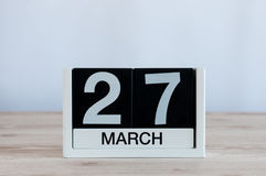 March 27th. Day 27 of month, everyday calendar on wooden table background. Spring time, empty space for text. World Stock Photos