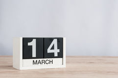 March 14th. Day 14 of month, wooden calendar on light background. Spring time. Commonwealth and International pi days. March 14th. Image of march 14 wooden color stock photo