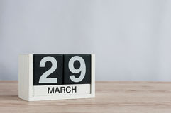 March 29th. Day 29 of month, wooden calendar on light background. Spring time, empty space for text. March 29th. Cube calendar for march 29 on wooden surface Royalty Free Stock Photos