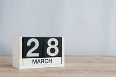 March 28th. Day 28 of month, wooden calendar on light background. Spring time, empty space for text Royalty Free Stock Photos